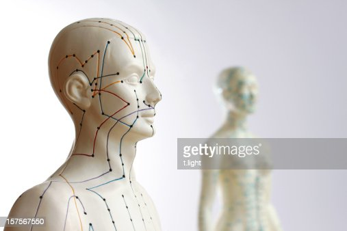 Two acupuncture models - Focus on male : Stock Photo
