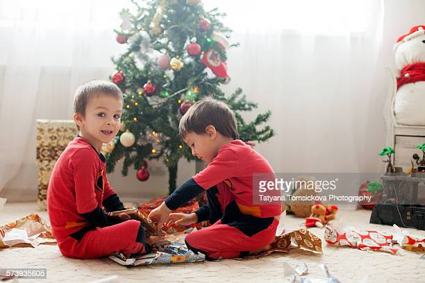 Two adorable boys, opening presents on Christmas