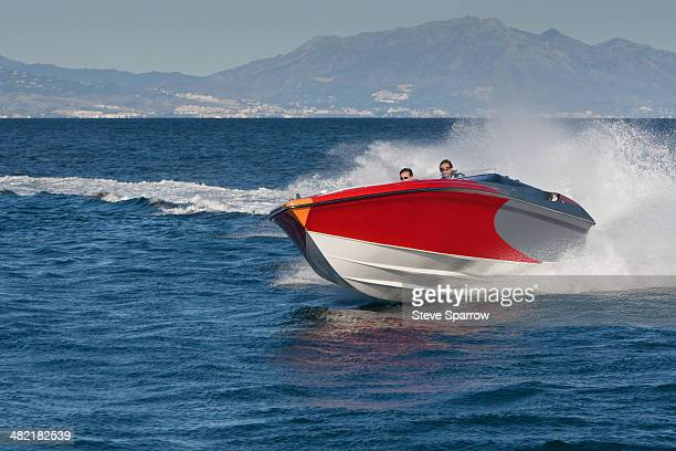 Two adult men having fun in speedboat, Sotogrande, Cadiz, Spain