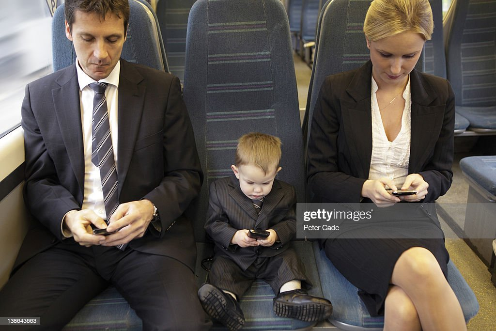 two adults and one baby executive sat on train : Stock Photo