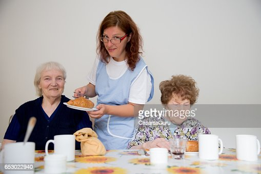 Two Adults Senior Having Breakfast Served : Stockfoto