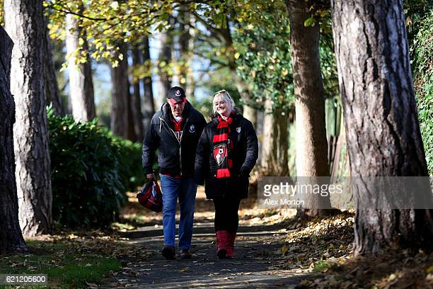 Two AFC Bournemouth fans make their way to the stadium prior to kick off during the Premier League match between AFC Bournemouth and Sunderland at...