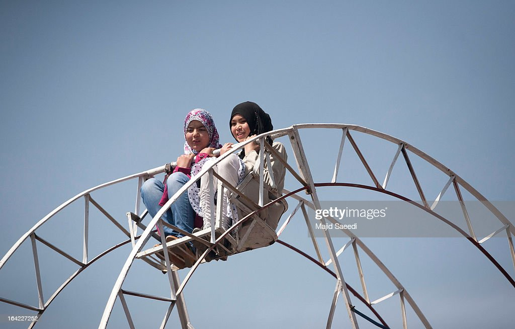 Two Afghan girls ride on a big wheel as they celebrate new year celebrations during the Nowruz festivities on March 21, 2013 in Kabul, Afghanistan. Nowruz is an ancient festival which marks the beginning of the spring equinox and the start of the year in the Iranian calendar, which this coming year will be 1392.