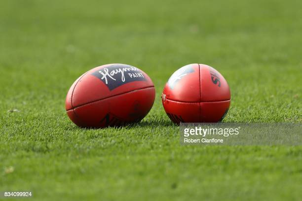 Two AFL Sherrin footballs are seen during a Melbourne Demons AFL training session at Gosch's Paddock on August 18 2017 in Melbourne Australia
