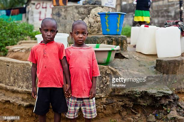 Two African Boys By Water Pump