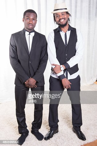 two african guys posing on a carpet : Stock Photo