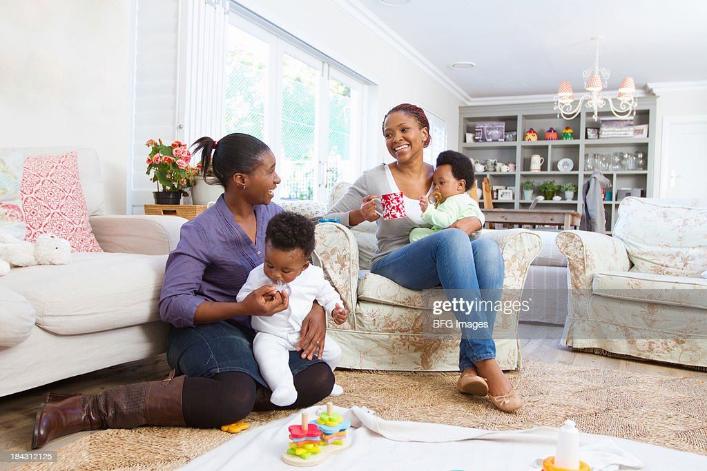 Two African moms and their babies at a play date, Cape Town, South Africa
