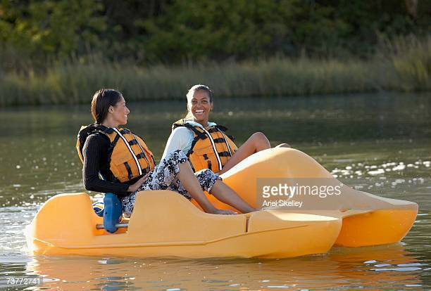 Two African women in paddle boat
