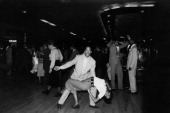 Two AfricanAmerican people dancing rock 'n roll in a nightclub New York April 1959