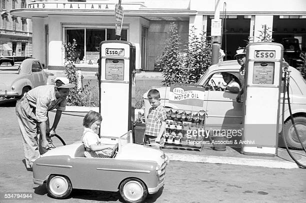 Two American children Jorie Pepper and Roger Jackson going around Rome on a toy car Rome 1952