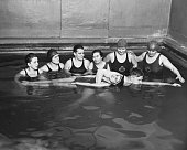 Two American Red Cross instructors giving a lifesaving class in a pool Chicago Illinois circa 1930