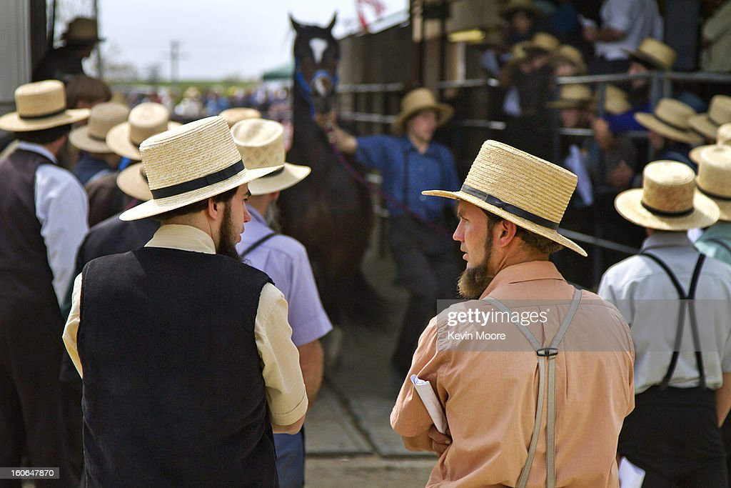 CONTENT] Two Amish men at a livestock auction at the Rawlinsville Amish Mud Sale in Lancaster County Pennsylvania. Rural, Pennsylvania Dutch