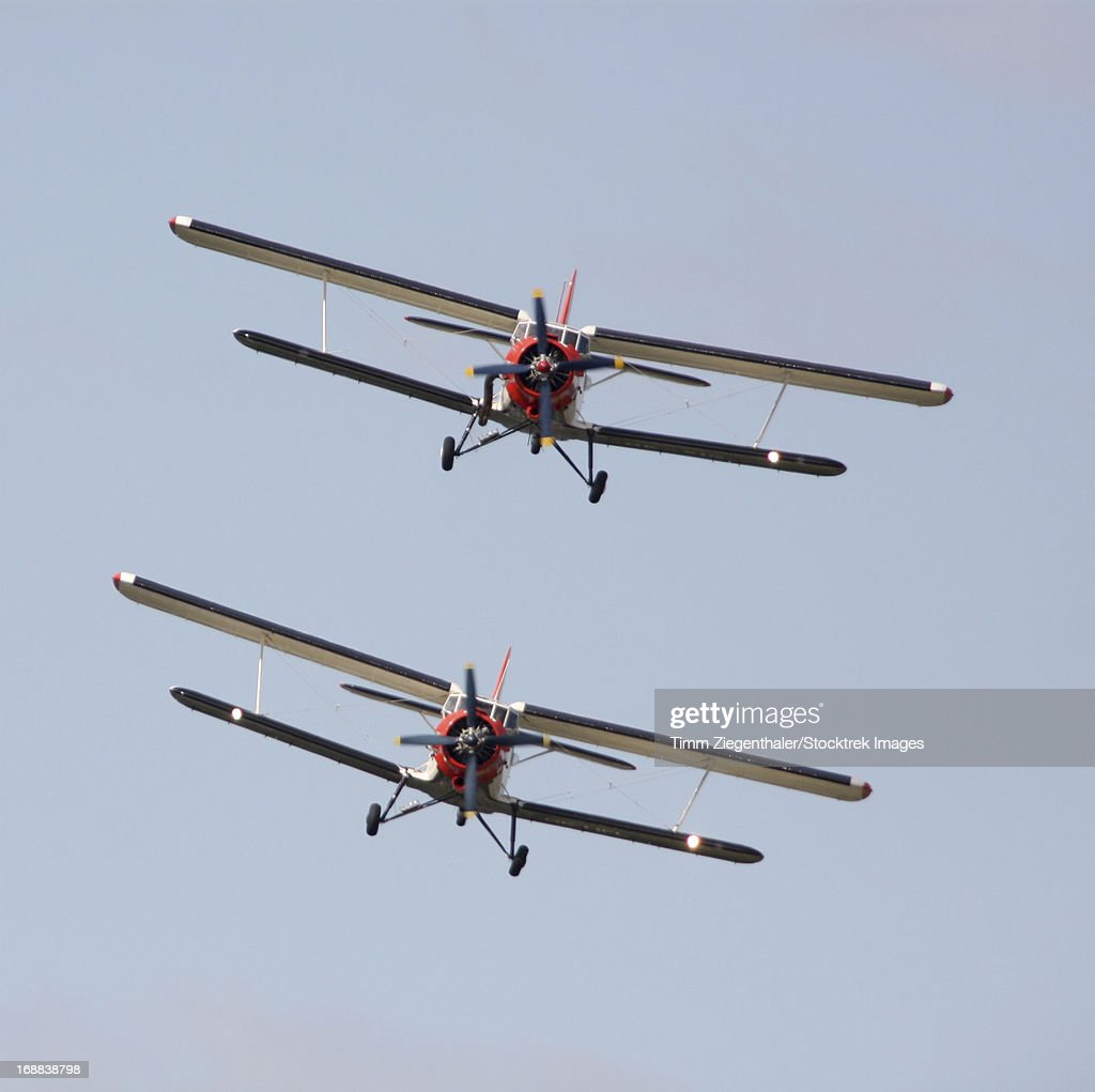 Two Antonow=v An-2 bi-planes in Formation over Czech Republic.