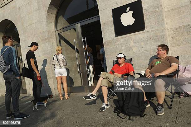 Two Apple fans camp out in front of the Berlin Apple store ahead of this coming Friday's sales launch of the new Apple iPhone 7 as other customers...