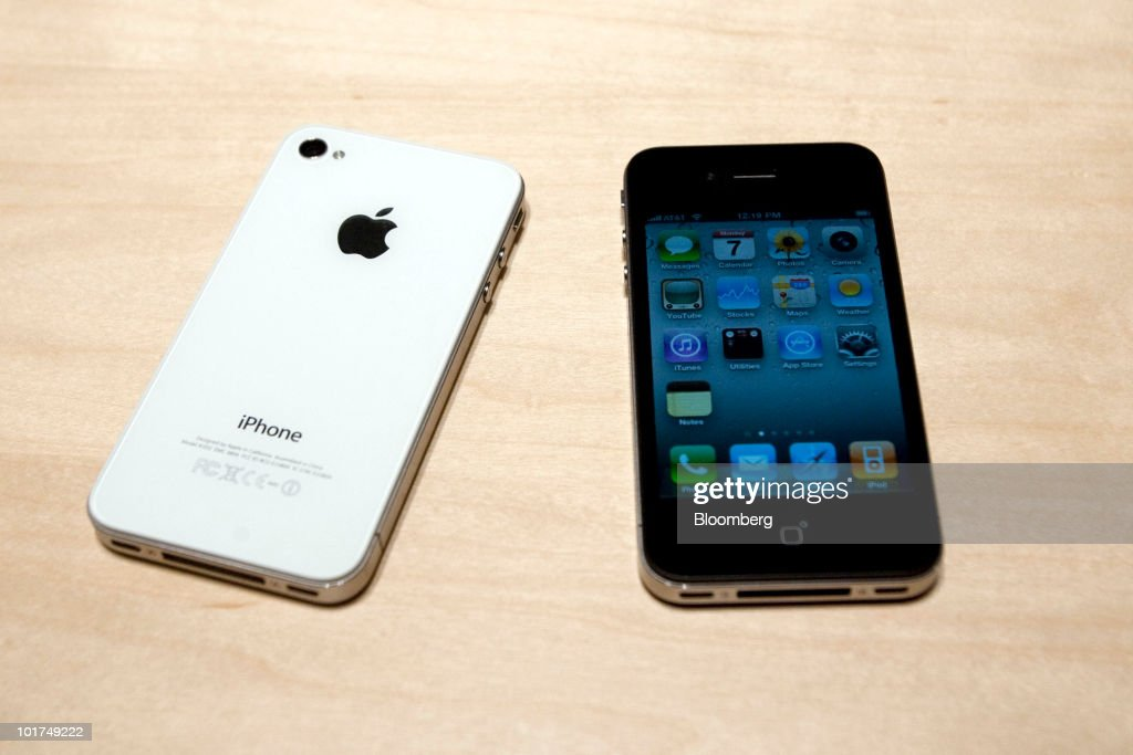 Two Apple Inc. iPhone 4's are arranged for a photo at the Apple Worldwide Developers Conference (WWDC) in San Francisco, California, U.S., on Monday, June 7, 2010. Apple Chief Executive Officer Steve Jobs introduced the redesigned iPhone 4 today, delivering a 24 percent thinner body and 100 new features as mobile competitors including Google Inc. work to usurp the smartphone's popularity. Photographer: David Paul Morris/Bloomberg via Getty Images