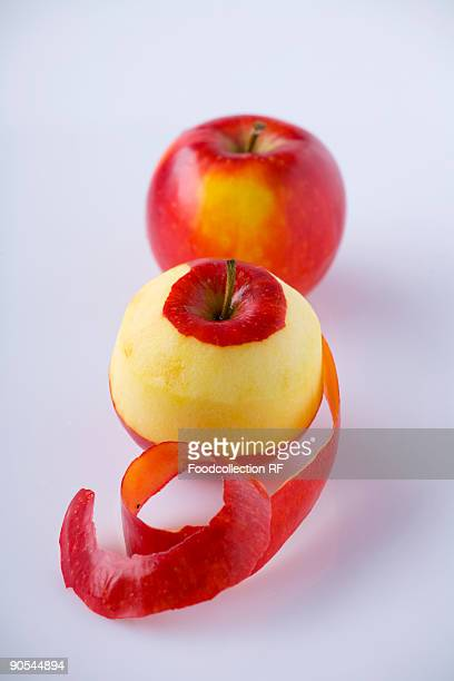 Two apples, one partly peeled