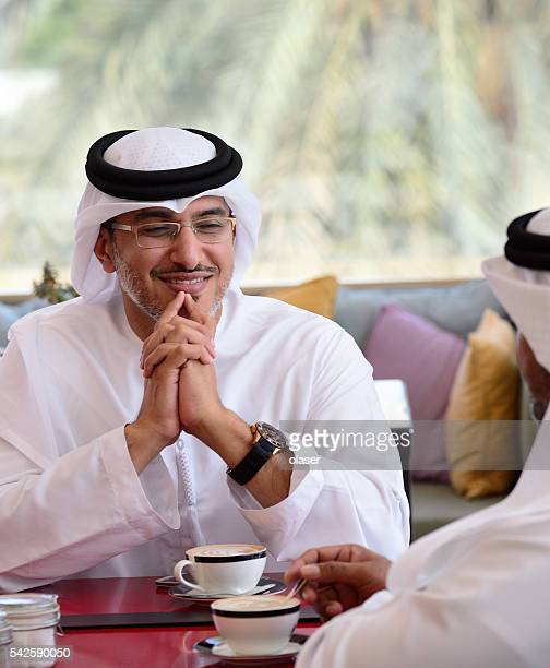 Two arab business men in cafe