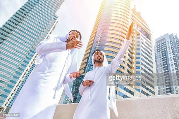 Two arab business people on the street