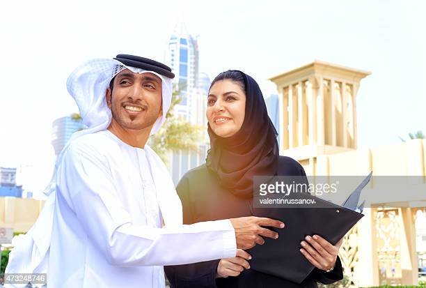 Two arab business people outside