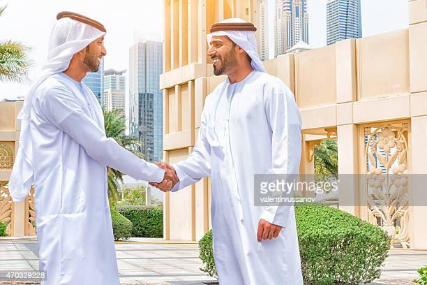 Two arab business people shaking hands