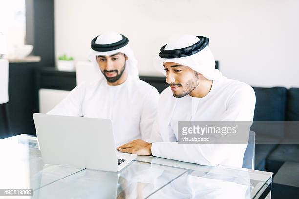 Two Arab Friends Watching Videos on Laptop