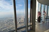 Two Arab men looking over Dubai from the Burj Khalifa