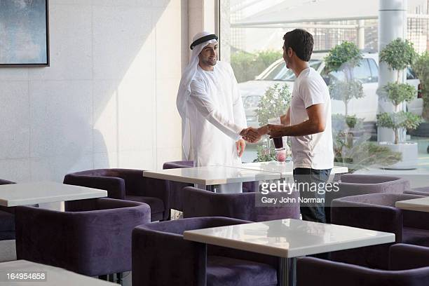 two arab men meeting in healthy food restaurant