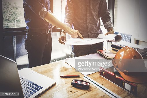 Two Architect man working with compasses and blueprints for architectural plan,engineer sketching a construction project concept. : Stock Photo
