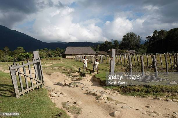 Two Arhuaco boys walk home with general view of Sierra Nevada landscape seen in the background on January 23 2015 in Nabusimake Colombia Nabusimake...