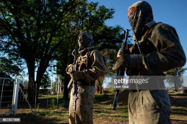 Two armed guards stand for a photo at the ranch of rhino breeder John Hume on October 16 2017 in the North West Province of South Africa John Hume is...