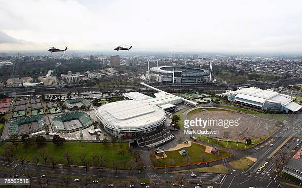 Two Army Sikorsky S70A9 Black Hawk helicopters fly above the MCG and Melbourne Park precinct on July 20 2007 in Melbourne Australia The No 171...