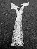 Two arrows on asphalt in London. 2008