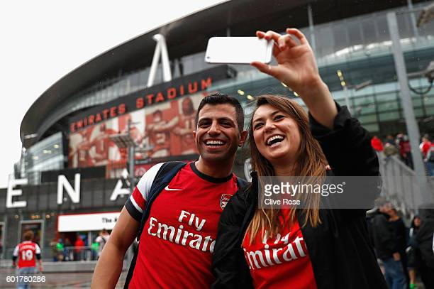 Two Arsenal fans take a selfie outside the stadium prior to kick off during the Premier League match between Arsenal and Southampton at Emirates...