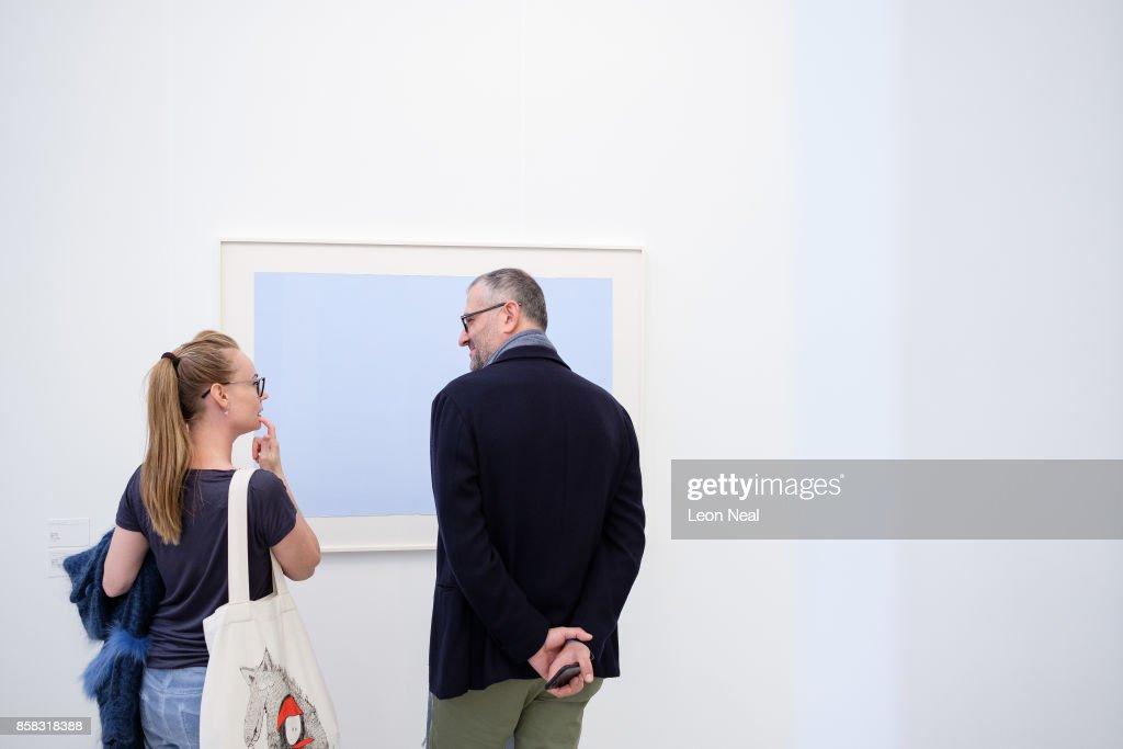 Two art lovers consider the merits of 'Truitt '67 (30)' by Anna Truitt at the Frieze Art Fair on October 6, 2017 in London, England. The annual event sees galleries showcase work by thousands of artists from around the world. The Frieze Art Fair runs from 5-8 October, 2017.