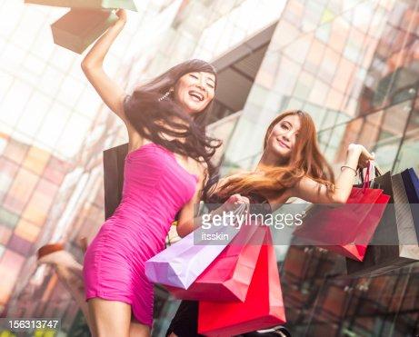 Two asian girls shopping