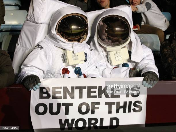 Two Aston Villa fans display a sign dedicated to Aston Villa's Christian Benteke in the stands before kickoff