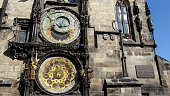 The astronomical dial, representing the position of the Sun and Moon in the sky, statues of various Catholic saints stand on either side of the clock and a calendar dial with medallions representing t