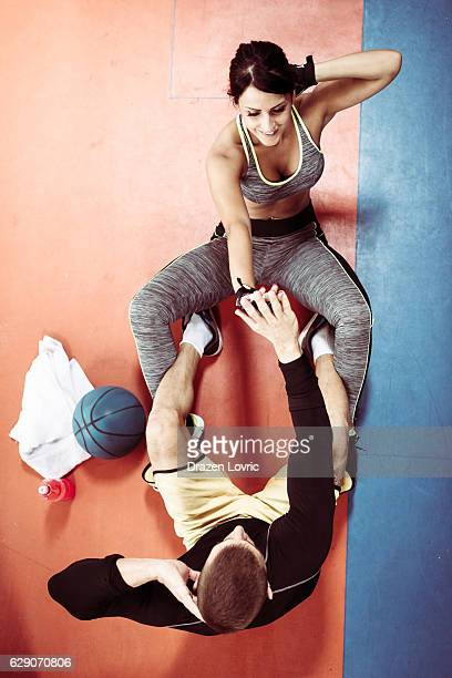 Two athletes in gym exercising together