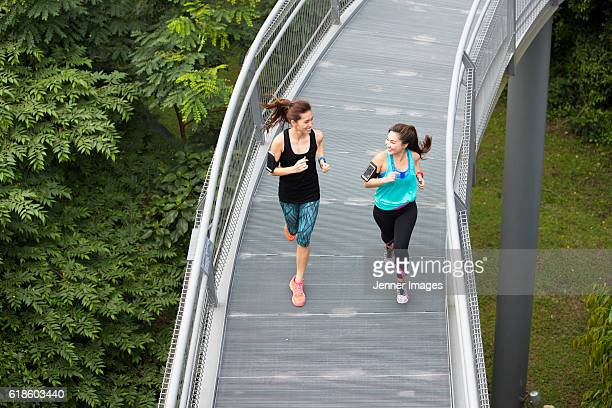 Two athletic women running.