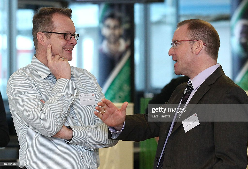 Two attendees talk during the DFB & DFL regional conference at AWD Arena on January 21, 2013 in Hanover, Germany.
