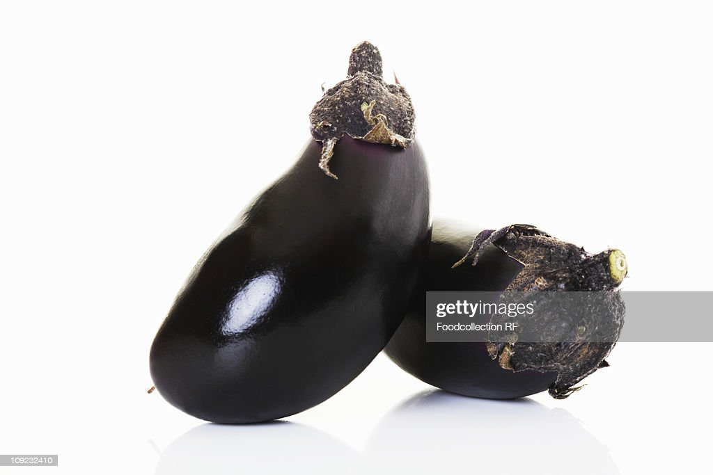 Two aubergines on white background, close-up : Stock Photo