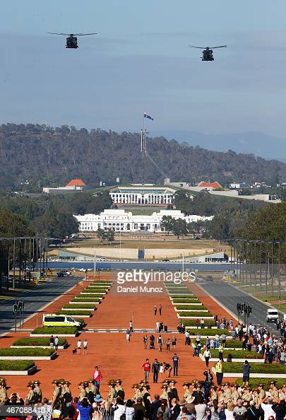 Two Australian Air Force helicopters fly over Parliament House during a parade to mark the end of Operation Slipper Australia's military campaign in...