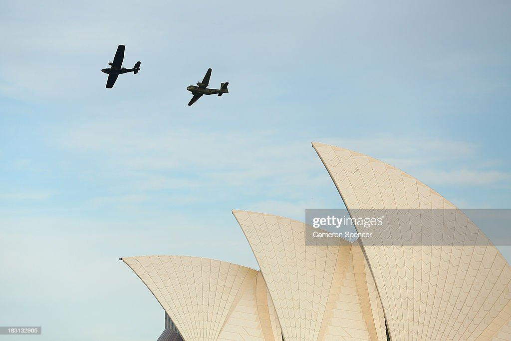 Two Australian Air Force planes fly over the Sydney Opera House during a 'Salute To Navy' Air Display on October 5, 2013 in Sydney, Australia. Over 50 ships participate in the International Fleet Review at Sydney Harbour to commemorate the 100 year anniversary of the Royal Australian Navy's fleet arriving into Sydney. Prince Harry is an official guest of the Australian Government and will take part in the fleet review during his two-day visit to Australia.