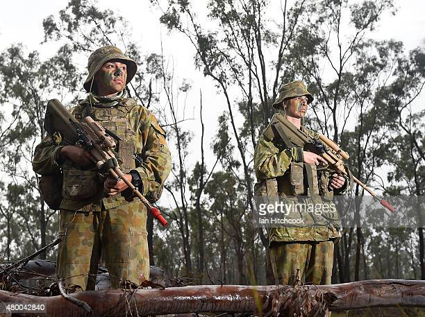 Two Australian female soldiers from 7 Brigade Headquaters pose as part of exercise Talisman Sabre on July 9 2015 in Rockhampton Australia Talisman...