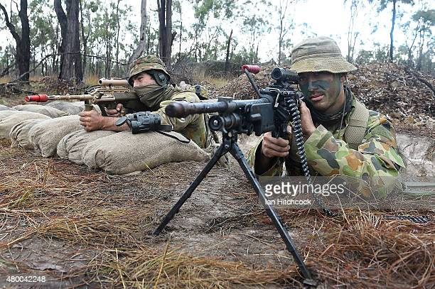 Two Australian soldiers from 7 Brigade Headquarters man a gun pit as part of exercise Talisman Sabre on July 9 2015 in Rockhampton Australia Talisman...