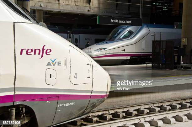 Two Ave highspeed trains wait at their platform at Seville's Santa Justa train station