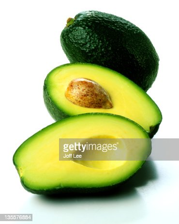 Two avocados - one halved : Stock Photo