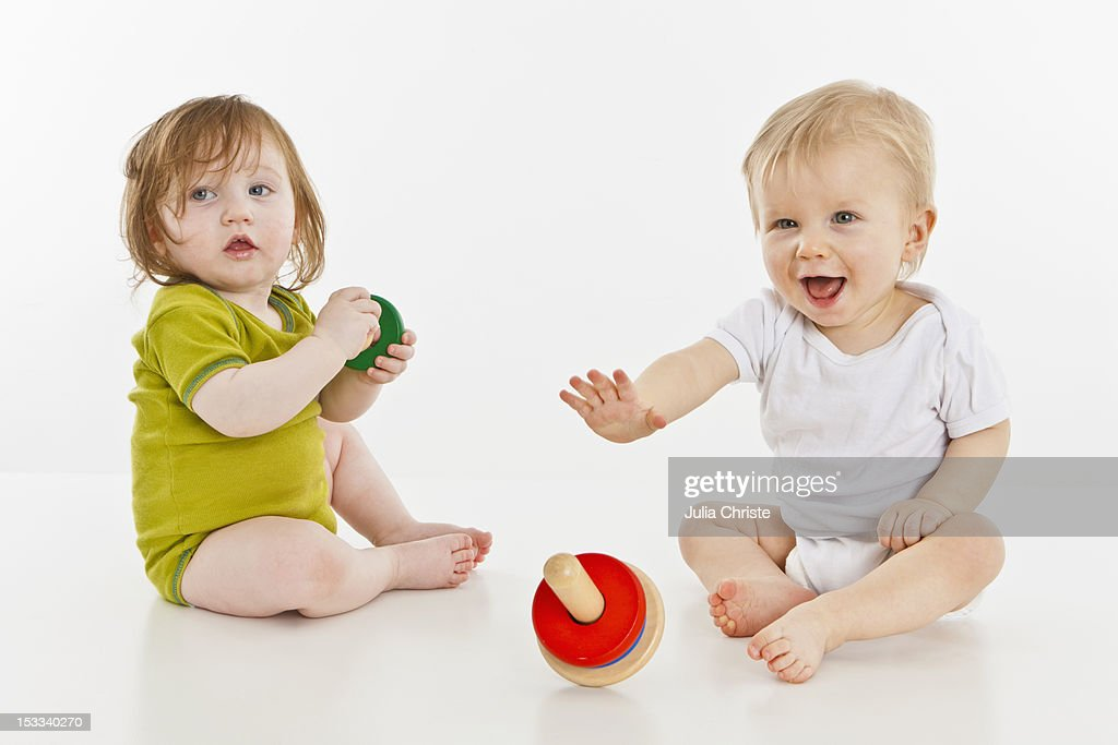Two babies playing together : Stock Photo