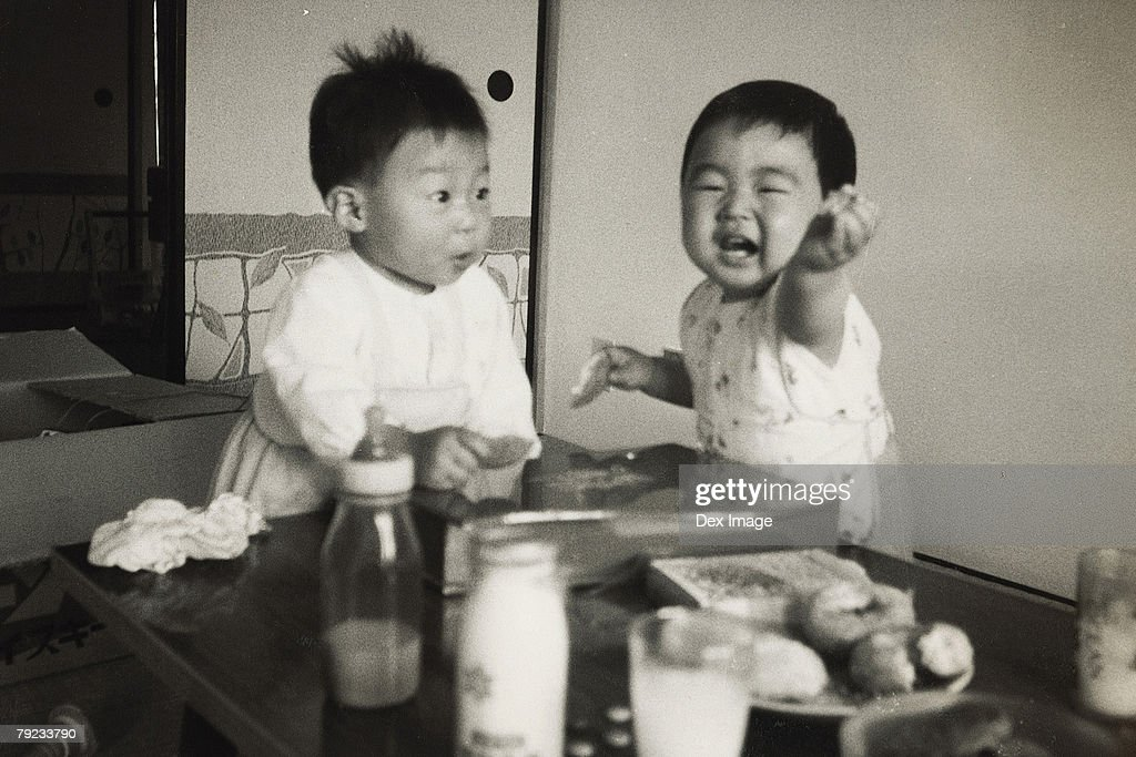 Two baby boys : Stock Photo