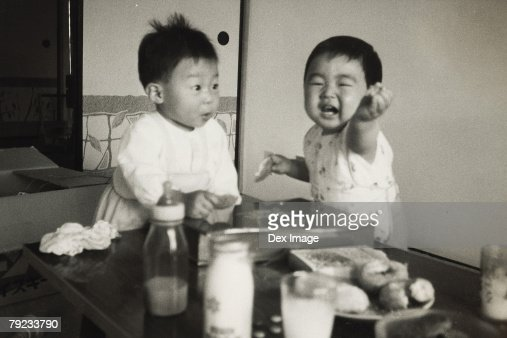 Two baby boys : Stock Photo